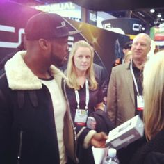@Alex Crabb and 50Cent at the @BlueFlame Gear  booth at CES 2014