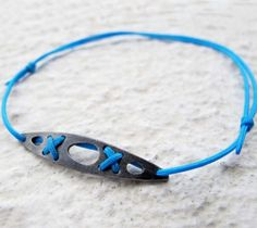Sea kayak silver bracelet – oxidized, turquoise, by Veró Lázár, for kayakers and sea lovers! Handmade. You can have it if you order it from Vero's webshop.