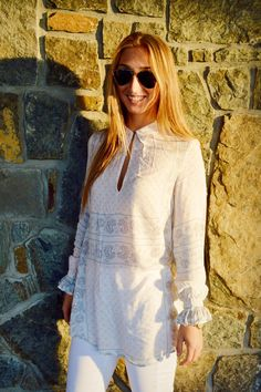 A stylish tunic with fun details paired perfectly with white jeans make for a great late summer go-to look.