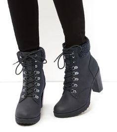 - Faux shearling cuff- Lace up fastening- Heel height: 4