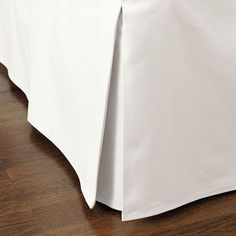 Add natural texture to your decor with a Ballard Bedskirt. Try a tailored style for clean lines, neutral color, and natural texture. The split corner, kick pleat construction allows the skirt to work on beds with and without corner posts. 16 drop. Dry clean.