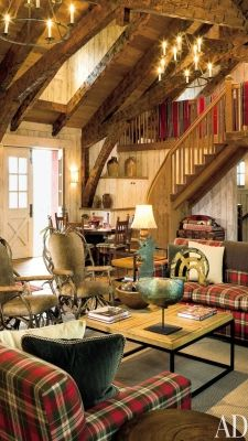 Rustic cottage with plaid couches | Architectural Digest