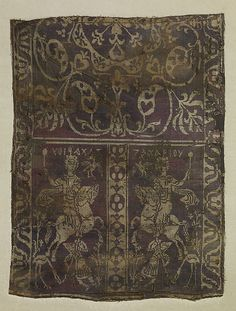 """Fragment of a Band with Noble Equestrian and Soldier, Inscribed """"Zacharaiou"""" in Greek Date: 7th-9th century (?) Geography: Made in Egypt or Syria (?) Medium: Weft-faced compound twill ( samit ) in reddish purple and beige silk"""