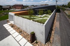 A Slanted Home With A Hidden Garden on the Roof
