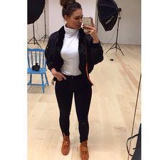 Black jeans, white col top, black jacket
