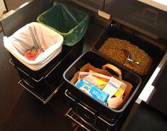 How To Organize Waste in a Small Kitchen Good use of awkward under-sink cabinet: install pull-out bins for trash, recycling, compost, etc.