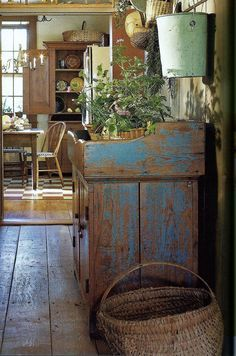 Love the old, worn dry sink..chippy bucket..and old basket......♥.