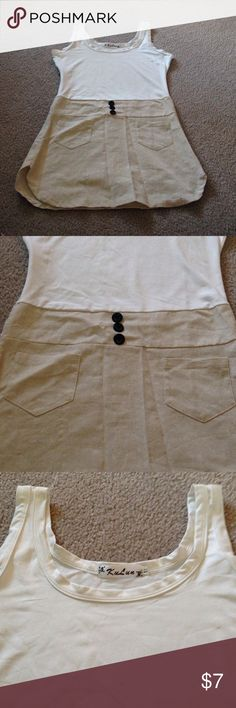 Cute Shirt/Short Dress Cream colored top that would pair nicely with leggings. Zip side. Front pockets and buttons. Runs smaller. KuLun Tops