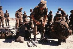 SADF conscripts return ammunition upon returning from patrol. 1989.