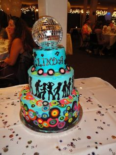 2 tier cake covered in buttercream with fondant accents. Topped...