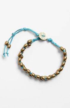This bracelet is hand-beaded by Massai Mamas in Kenya.