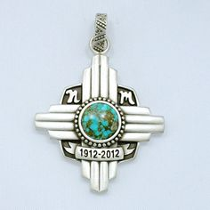 New Mexico Centennial Pendant Zia Symbol 100 Sterling Silver Turquoise. $ 195.00, via Etsy.