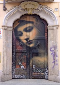 Lovely face of woman on door.