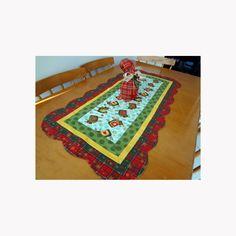 Trilho de mesa natalino com alegres Renas, para dar um toque de alegria a decoração do natal, confeccionado com tecidos nacionais e importados, em algodão. <br>Tamanho 102 cm X 50 cm