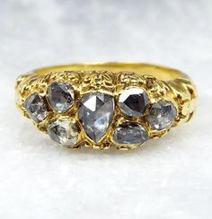A beautiful solid 18ct yellow gold ring, made in the Georgian era. A stunning, rare design that we have never seen before. This ring is set with a