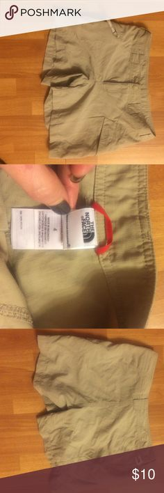The North Face shorts. Size 4 The North Face shorts. Size 4. Shorts are 100% nylon. Lightweight. Khaki colored. 2 side pockets- one is a zip pocket. These shorts have never been worn- only tried on. The North Face Shorts
