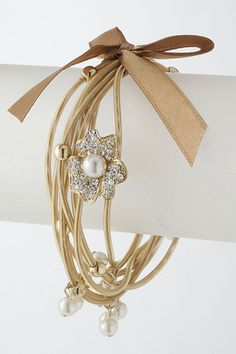 Gold Crystal Daisy Charm Bracelet. Food for thought! I'll bet we could make some of these ourself! Wanna try it?