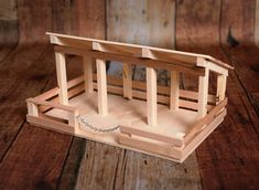 Live in a small space? This Wooden Toy Stable is perfect to be carried from room to room and provide hours of fun!!