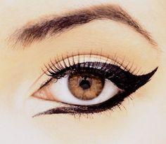 dramatic winged eyeliner.