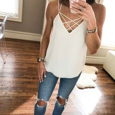 All about this strappy cami (wearing xs) & under $40! Also these jeans that a lot of y'all wanted are back in stock & under $90! You could wear this with a cute cardigan on top for spring & into the summer with shorts //  Screenshot or 'like' this pic to shop the product details from the new LIKEtoKNOW.it app, available now from the App Store! http://liketk.it/2qIzR #liketkit @liketoknow.it