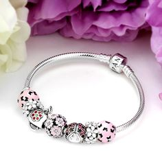 PANDORA Spring Planting Charm Bracelet -  This garden is VERY BUZZ-Y!  The PANDORA Spring Planting Charm Bracelet features bright pink enamel charms, flowers, butterflies and ladybugs, complete with a watering pitcher!