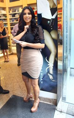 Kim Kardashian wearing Yves Saint Laurent Tribtoo Pumps in Nude Alexander Wang Drapey Stretch Sequin Skirt. Kim Kardashian The Apprentice June 22 2010.
