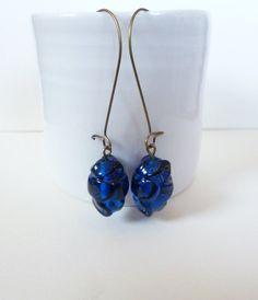 Handmade blue lampwork earrings on bronze earring hooks. Available at NiikNakks on etsy.com Thanks!
