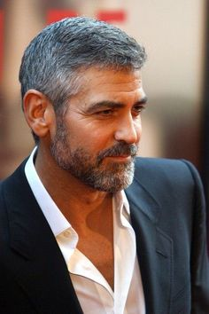 George Clooney. Even when dressed down, George looks dressed up. With or without a tie. Well done.
