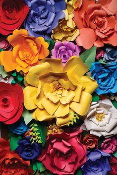 DIY Easy Giant Paper Flower Tutorial and Template from Hostess with the Mostess. These giant flowers can be made in a few steps with any type of paper. They would make a gorgeous spring or summer party background.
