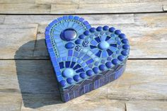 Beautiful heart shaped wooden box covered with blue glass mosaic and beads. Finished surfaces inside and out. The bottom is covered with soft green
