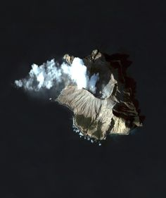 Whakaari / White Island, Bay of Plenty, New Zealand - photo by dailyoverview  (4/9/16);  Thirty miles from the North Island, Whakaari is New Zealand's most active volcano, and has been built up by continuous eruptions over the past 150,000 years. The island is approximately 1.2 miles in diameter and rises to a height of 1,053 feet above sea level.
