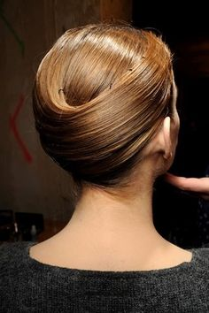 """oribehaircare: """" We can't get over how unbelievably sleek this look from the Spring/Summer 2011 Giorgio Armani Privé show. Oribe educator Adam Livermore wrapped the hair with Imperméable and Superfine. French Twist Hair, Up Hairstyles, Pretty Hairstyles, Wedding Hairstyles, Runway Hair, Armani Prive, Great Hair, Hair Art, Up Dos"""