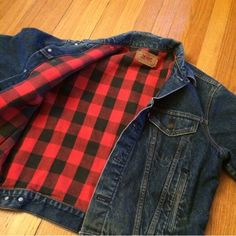 """Vintage Levi's Buffalo Plaid Lined Jean Jacket Okay how awesome is this?! A vintage Levi's denim jean jacket lined with warm buffalo plaid red and black fabric. Originally a men's style, it completes any gal's hipster/vintage look! Marked size 44 but would do best on a L in my opinion, but could work on an XL and would fit more oversized on a M as well. Relaxed roomy fit. When buttoned & laying flat: 23"""" long, 21.5"""" across armpit to armpit, 24"""" sleeve. Excellent vintage condition. These go…"""
