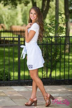 This adorable monogrammed skirt is so perfect for ladies who love to wear monogrammed apparel! It's a great way to show off your monogram during the spring and summer! Featuring a cute blue seersucker print, this skirt is easy to style with white or blue blouses. It also has elastic around the waist, ruffles at the top hemline, and a matching fabric belt that can tie into an adorable bow!