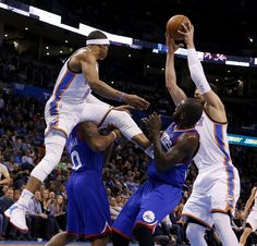 Oklahoma City's Russell Westbrook (0) comes down on Philadelphia's Isaiah Canaan (0) as Oklahoma City's Enes Kanter (34) tries to get the ball beside Philadelphia's Jason Richardson (23) during an NBA basketball game between the Oklahoma City Thunder and the Philadelphia 76ers at the Chesapeake Energy Arena in Oklahoma City, Wednesday, March 4, 2015. Photo by Bryan Terry, The Oklahoman