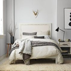 Blue grey walls and pillows, yellow beige carpet and bedding.