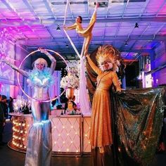 J&D Entertainment stilt characters and aerialist at Silver Street Studios, wedding entertainment, Hora Loca, Quinceanera, LED stilt character, LED hoop, ises wings, headdress, J&D Entertainment in Houston, Texas www.jdentertain.com