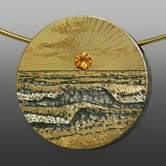 "Wolfgang Vaatz: , Pendant in 18k gold, sterling silver, and 4mm sapphire. Pendant only, neckwire not included. 1 1/4"" diameter."