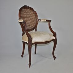 18th century Georgian style oval back fauteuil.