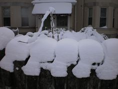 The top of the wall wearing a heavy coat of snow.