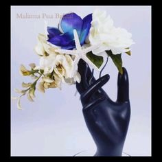 Silk Blue orchids, Ivory Wisteria and Gardenia create the stunning Wedding headpiece.