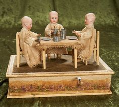"""German Handwind Mechanical Toy """"Three Little Children at Tea Table"""" by Zinner and Sohne."""