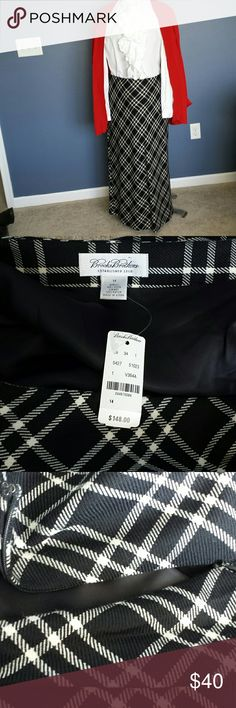 NWT Brooks Brothers full length wool skirt New with tags luxurious Brooks Brothers black and white wool skirt. Lining is 100% rayon. This full length skirt is sure to keep you cozy despite the cold temperatures of winter. Never have been worn. Blouse and sweater not included Brooks Brothers Skirts A-Line or Full