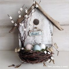 Decorative idea for Easter...a birdhouse outside door, made of wood and natural materials with details in paper and crochet. (Italian Blog)