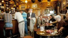 In this 1985 photograph, customers – mostly men – gather at a pub in Northumberland (Credit: Credit: David Davies/Alamy Stock Photo)