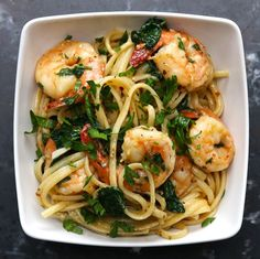 8 oz linguine 2 Tbsp. olive oil 8 Tbsp. (1 stick) butter 4 cloves garlic, minced 1 tsp crushed red pepper 1¼ lbs large shrimp Salt pepper 1 tsp dried oregano 4 cups baby spinach ¼ cup Parmesan 2 Tbsp. parsley, chopped 1 Tbsp. lemon juice.