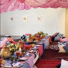 Brita Olsen Creative - Guests at this Brooklyn venue dined on a Moroccan-inspired meal, under a giant pink parachute. Event Design: Brita Olsen Creative Florist: Peartree Venue: The Sky Gallery