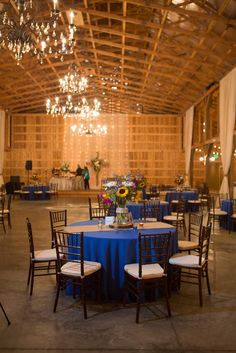 Royal Blue and Burlap Dining Table | Imago Interior Design | Two Bee Events | Saddle Woods Farm | Amber Davis Photography https://www.theknot.com/marketplace/amber-davis-photography-nashville-tn-518033