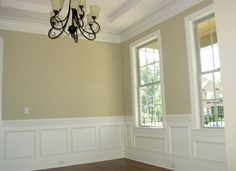 Wainscoting under window They have pre made panels at Lowe's now  Genius!!!!!