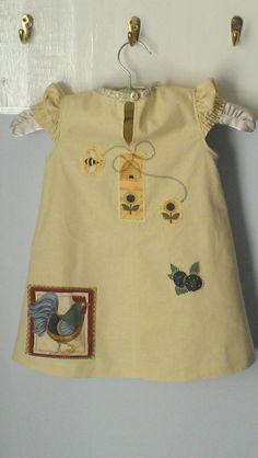 Reverse of little girl's gardening sundress. Simplicity 2684
